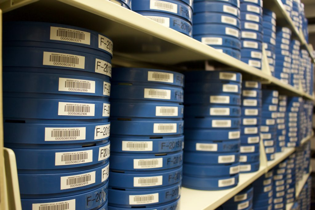 Film cans from the Florentine Films Collection in the stacks at Wilson Library