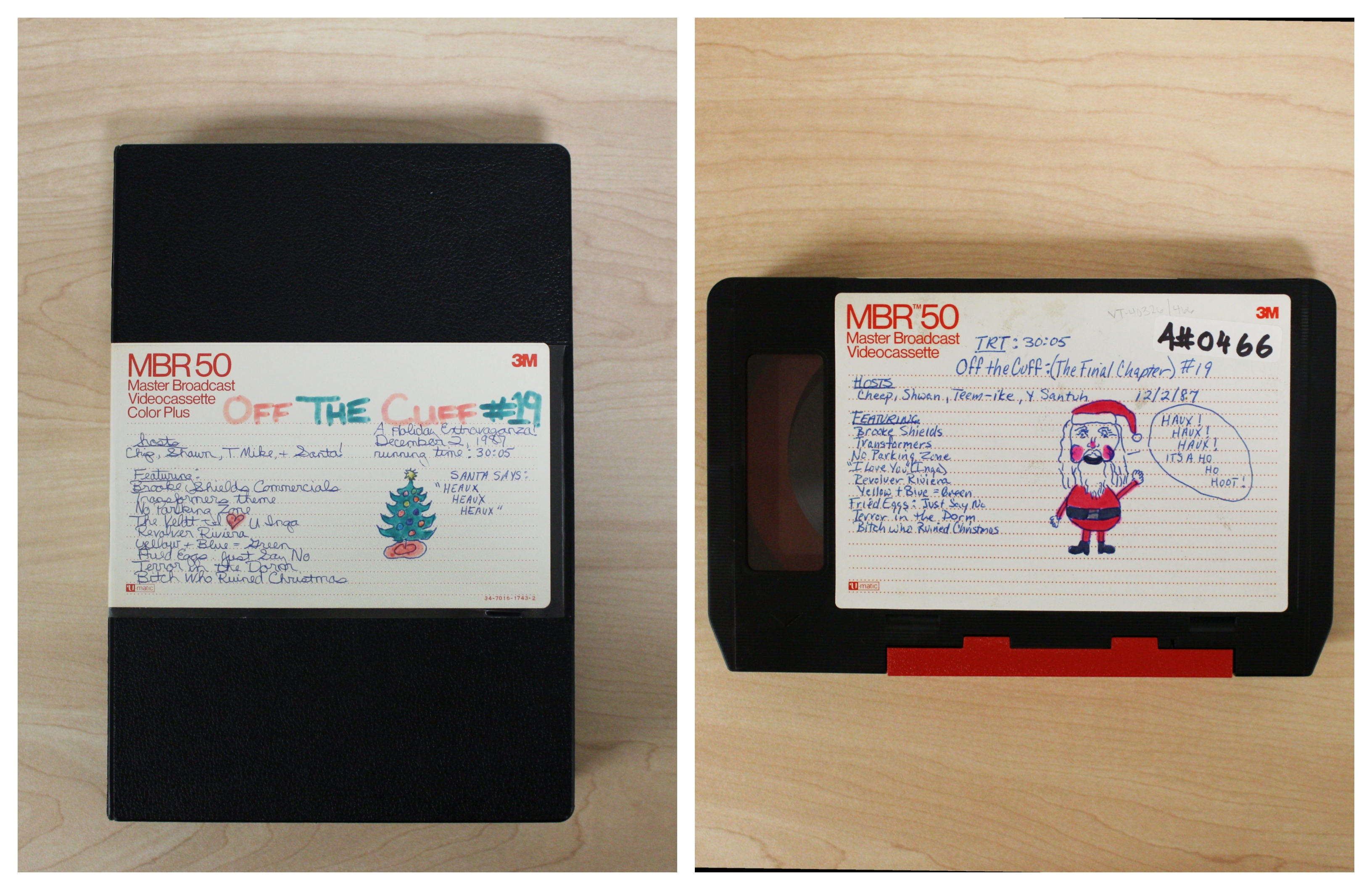 "Photo collage of a U-matic case and tape for ""Off the Cuff #19: A Holiday Extravaganza!"" One has a drawing of a Christmas tree on the label; the other a drawing of Santa."