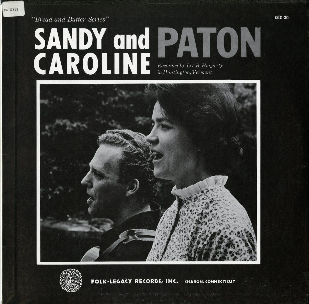 LP cover, features black and white photograph of Sandy and Caroline Paton singing outside