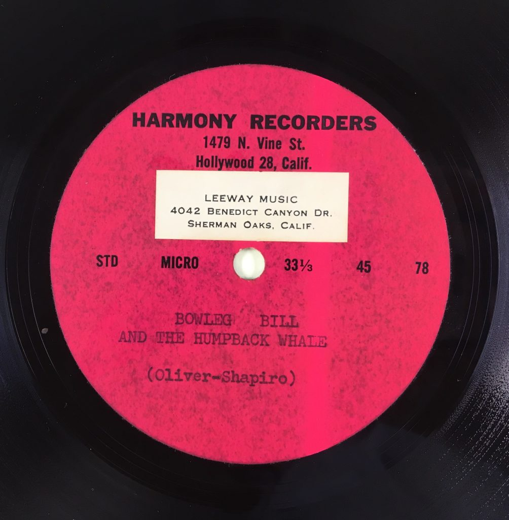 "Record Label with sticker on label. Reads ""Harmony Recorders, 1479 N. Vine St. Hollywood 28, Calif. Bowleg Bill and the Humpback Whale (Oliver-Shapiro)."" Sticker reads ""Leeway Music, 4042 Benedict Canyon Dr. Sherman Oaks, Calif."""