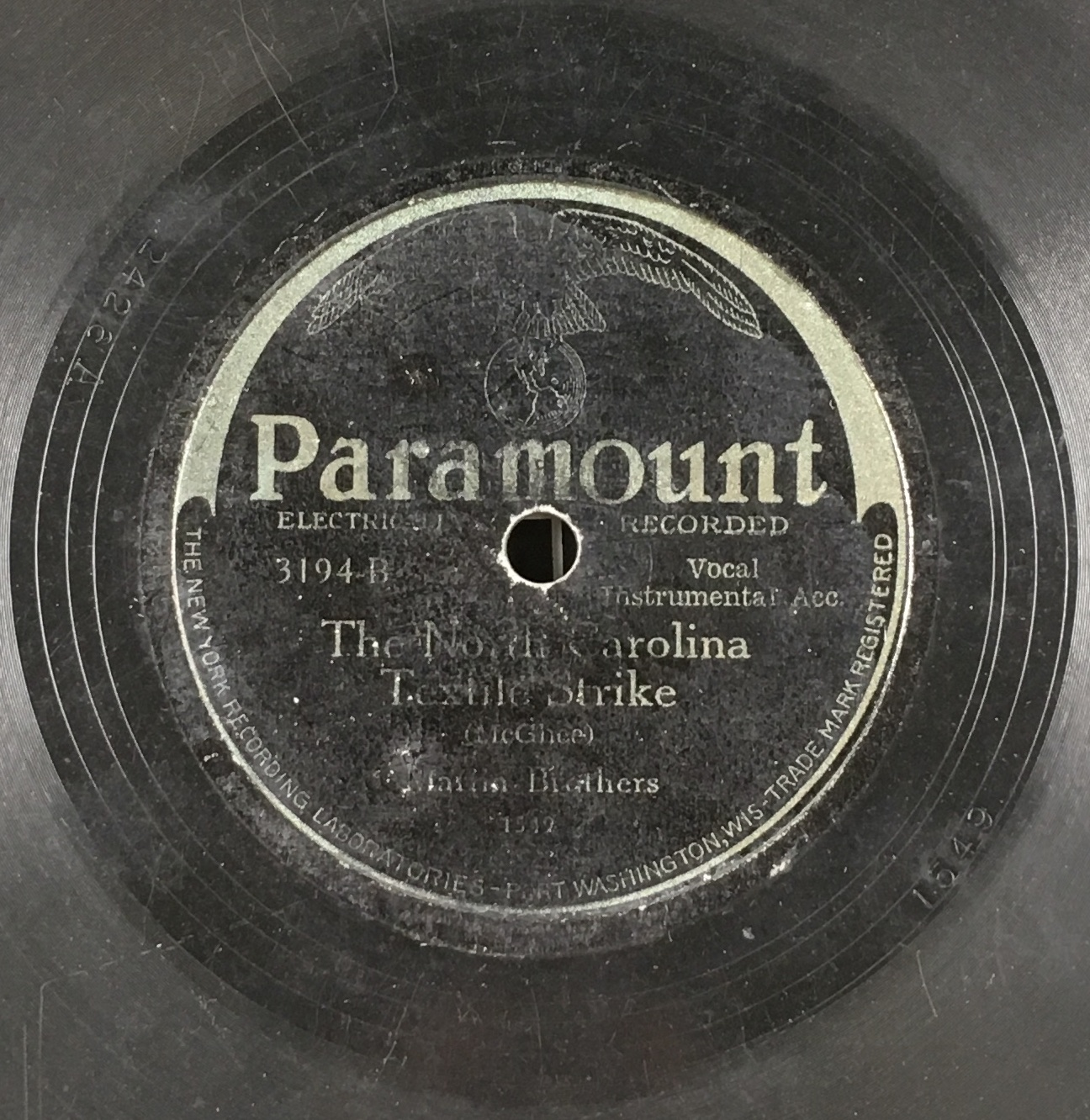 "Record label for 78RPM record. Text reads: Paramount, Electrically Recorded. 3194-B. Vocal, Instrumental Acc. The North Carolina Textile Strike (McGhee). Martin Brothers. Bottom of label reads: ""The New York Recording Laboratories - Port Washington, Wis-Trade Mark Registered."""