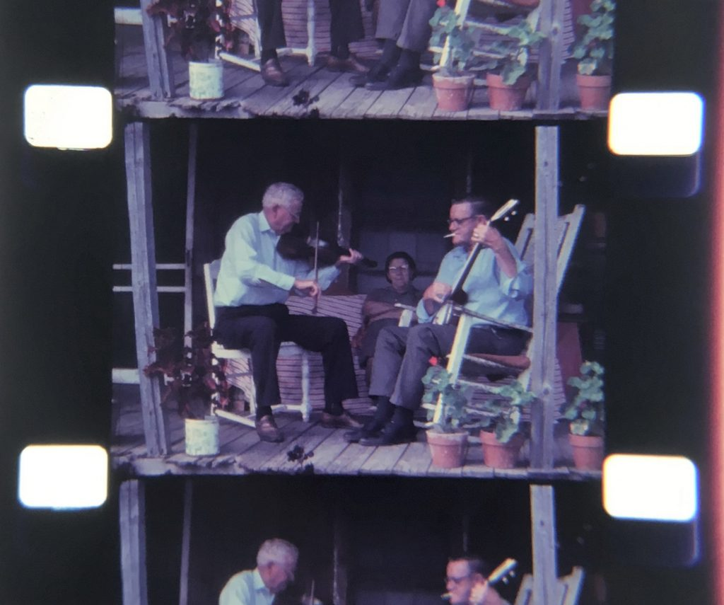 Tommy Jarrell and Fred Cockerham playing fiddle and banjo on Fred Cockerham's porch in Low Gap, North Carolina