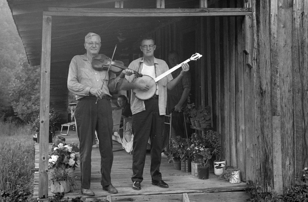 black and white photo of Tommy Jarrell and Fred Cockerham on Fred Cockerham's front porch
