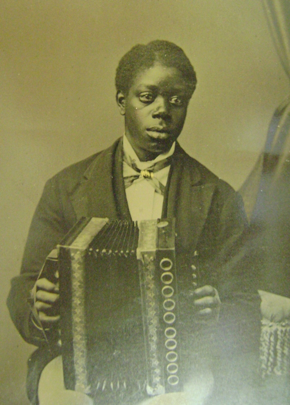 Unidentified man holding accordion, circa 1880-1900.
