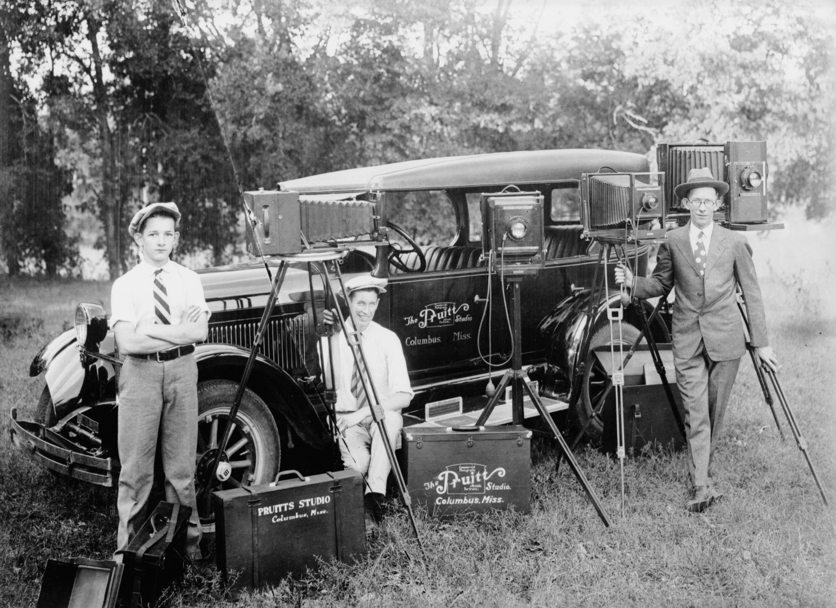 O.N. Pruitt (right) with his son Lambuth (far left) and probably Pruitt's brother Jim (center). Both Lambuth and Jim also worked as photographers. Photograph circa 1925.  The Otis Noel Pruitt and Calvin Shanks Photographic Collection #05463, Southern Historical Collection, The Wilson Library, University of North Carolina at Chapel Hill.