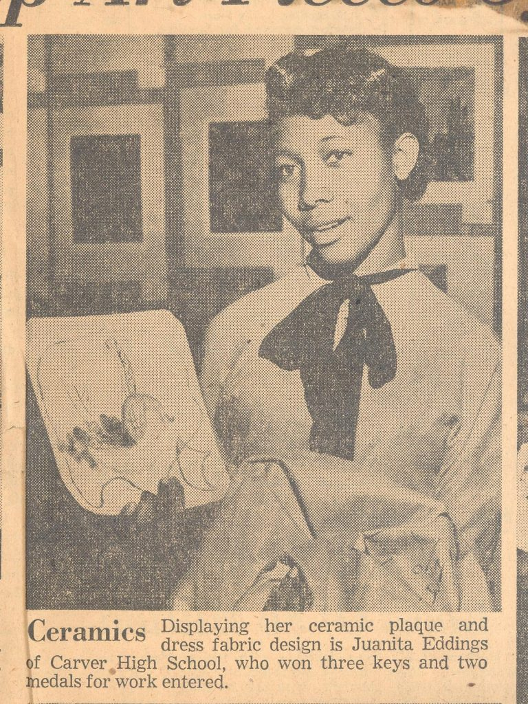 Photo of Juanita Eddings, student of J. Eugene Grigsby Jr from Carver High School., showcasing a ceramic which she won an award for.