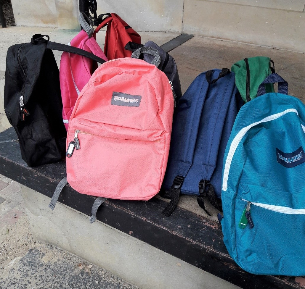 A group of colorful backpacks.