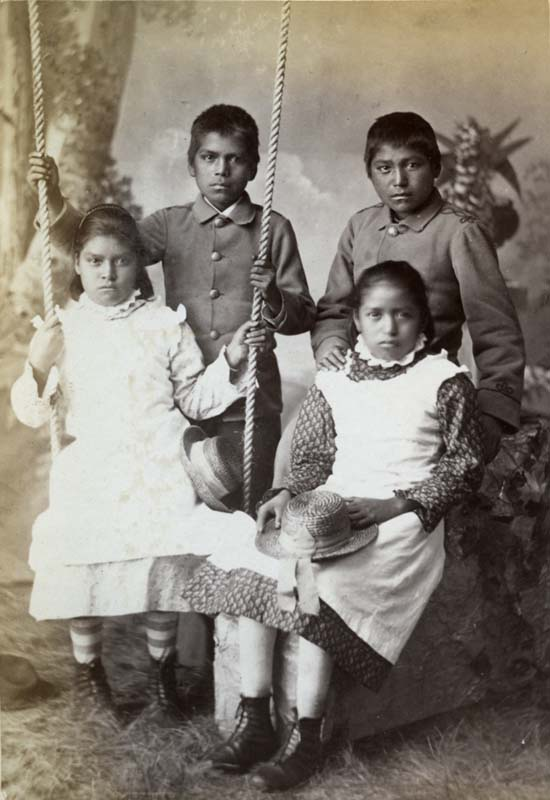 Four Pueblo students after five months at the Carlisle Indian Industrial School.