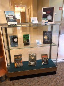 books on a three-shelf display case