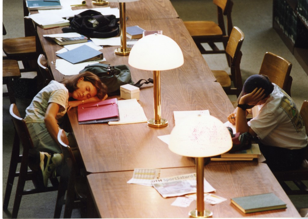 One sleeping, one studying. From the Design Services Department Records, box 6, Collection #40324).