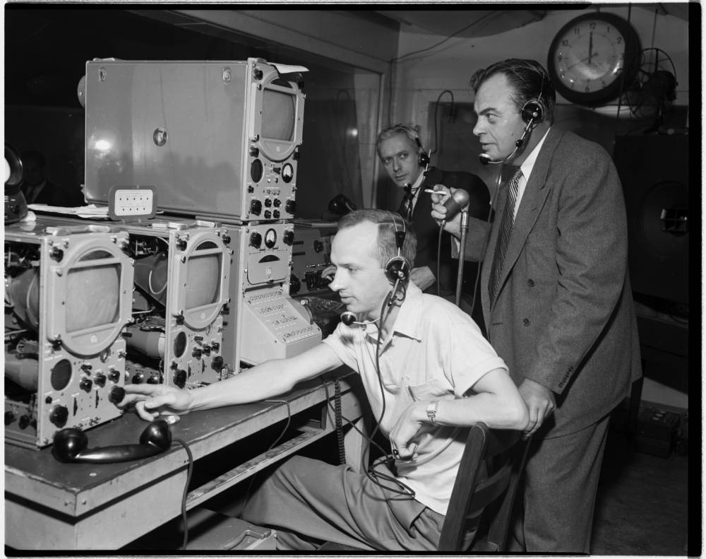 Department of Radio, Television, and Motion Pictures (RTVMP): Three men with equipment, circa 1952 #P0031