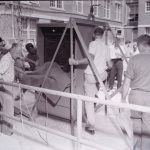 """""""Computation Center: Men unloading UNIVAC"""" From the University of North Carolina at Chapel Hill Photographic Laboratory Collection, 1946-1990 (#P0031/18391)"""