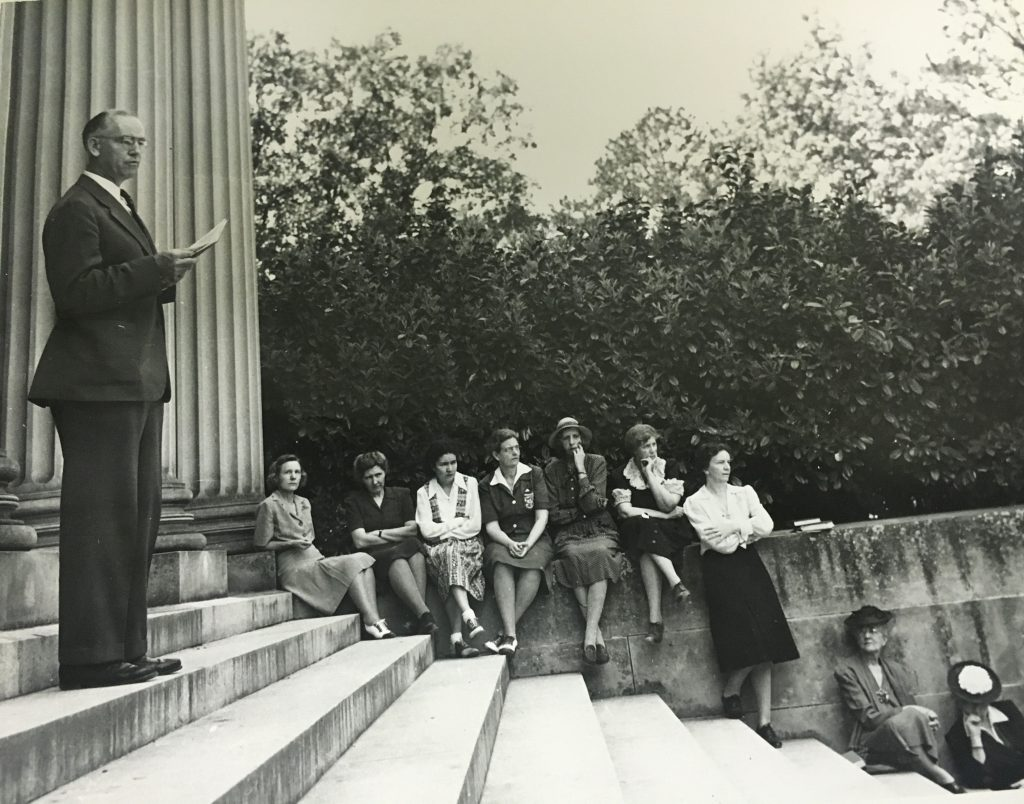 Students listen to the speaker at the observance of the 1933 Nazi Book Burning on the steps of Wilson Library, 1943