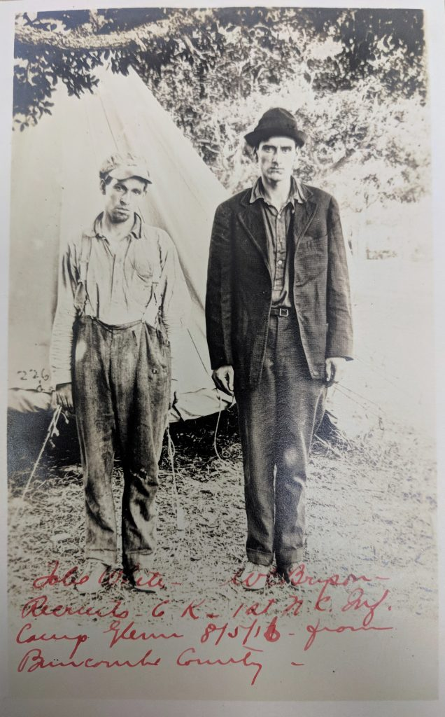 two men in front of tent 1916