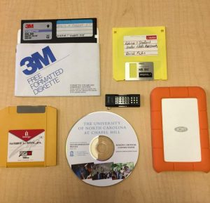 "Image shows a 3.5"" floppy disk, yellow zip disk, 5.25"" floppy disk, CD, USB thumb drive, and external hard drive."