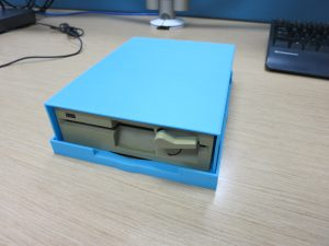 "3d printed blue case housing a 5.25"" floppy drive"