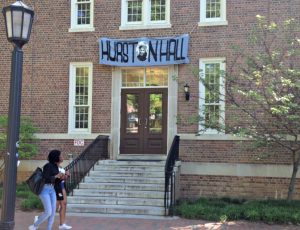 "Banner reading ""Hurston Hall"" displayed over the door of Saunders Hall in 2015."